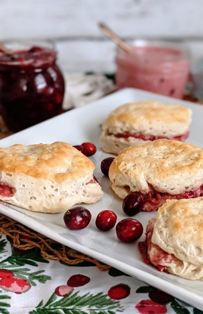Plated Cranberries & Cream Biscuits on surrounded with cranberry sauce and cranberry and cream sauce.