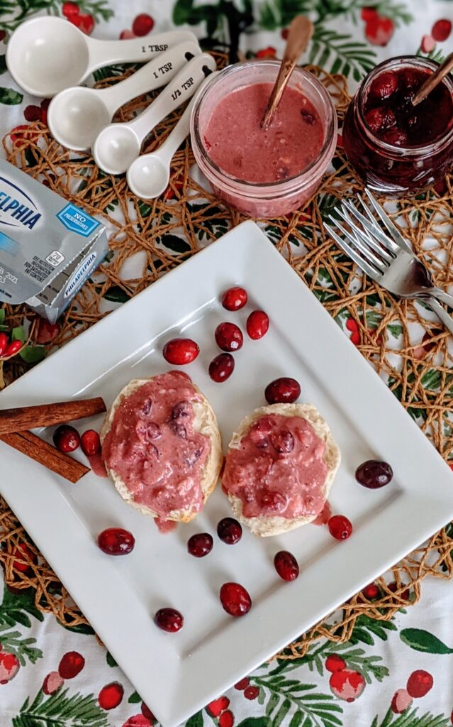 Open-faced cranberries and cream biscuits surrounded with cranberry sauce and cranberries and cream sauce.