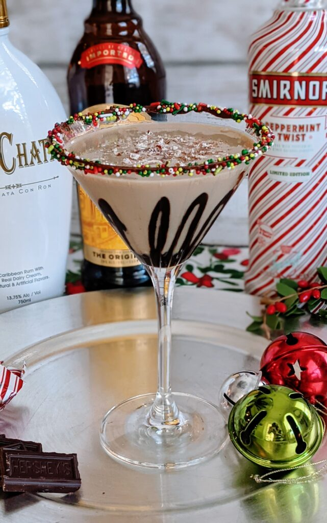 Peppermint Mocha Martini on decorative plate surrounded with liquor.