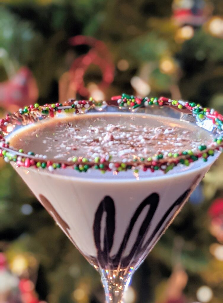 Close up of the Peppermint Mocha Martini in front of a Christmas tree.