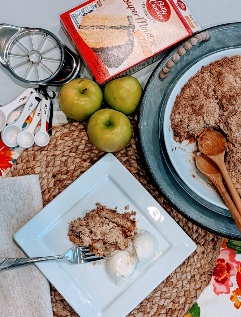 Apple crisp served in a large white bowl with 2 wooden spoons.  Apple crisp on a white square plate with 2 scoops of vanilla ice cream. With Granny Smith apples and measuring spoons alongside.