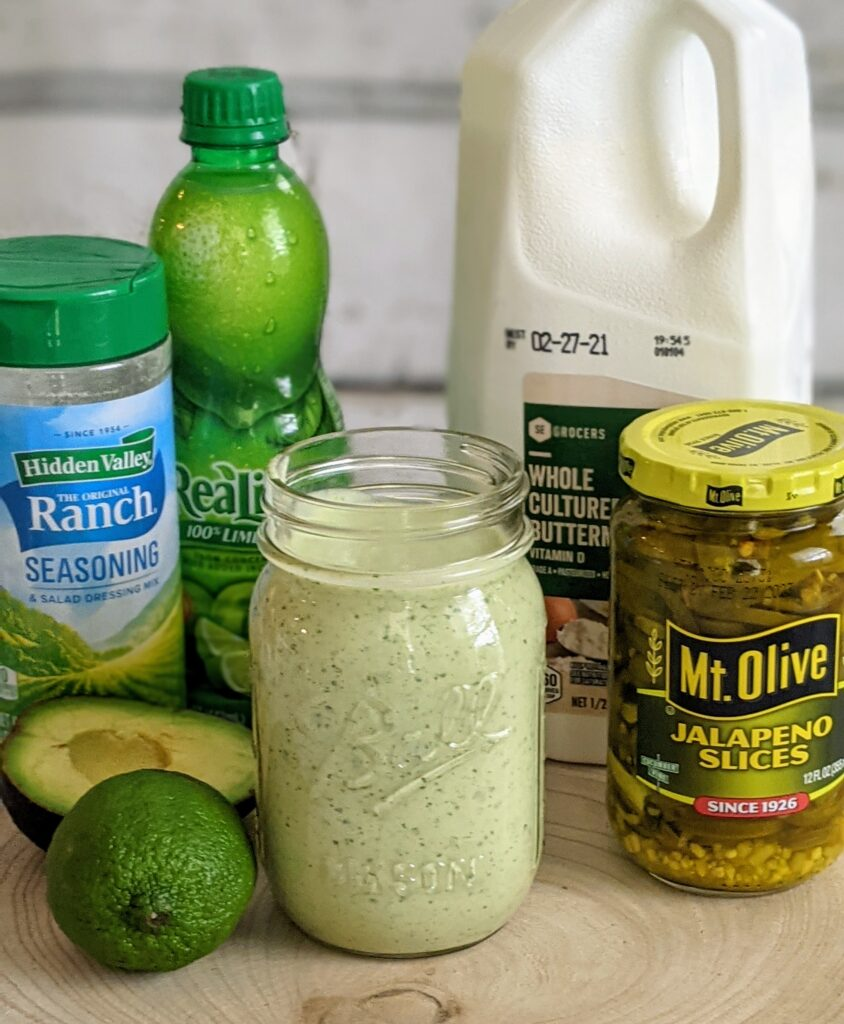Finished Avocado Cilantro Dressing with surrounding ingredients.