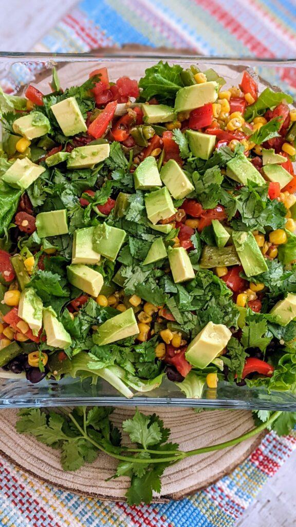 Salad with added progression of avocado and cilantro.