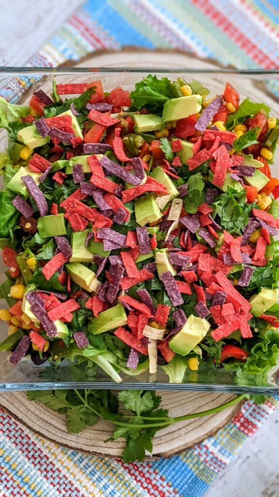 Salad with added progression of tortilla strips.