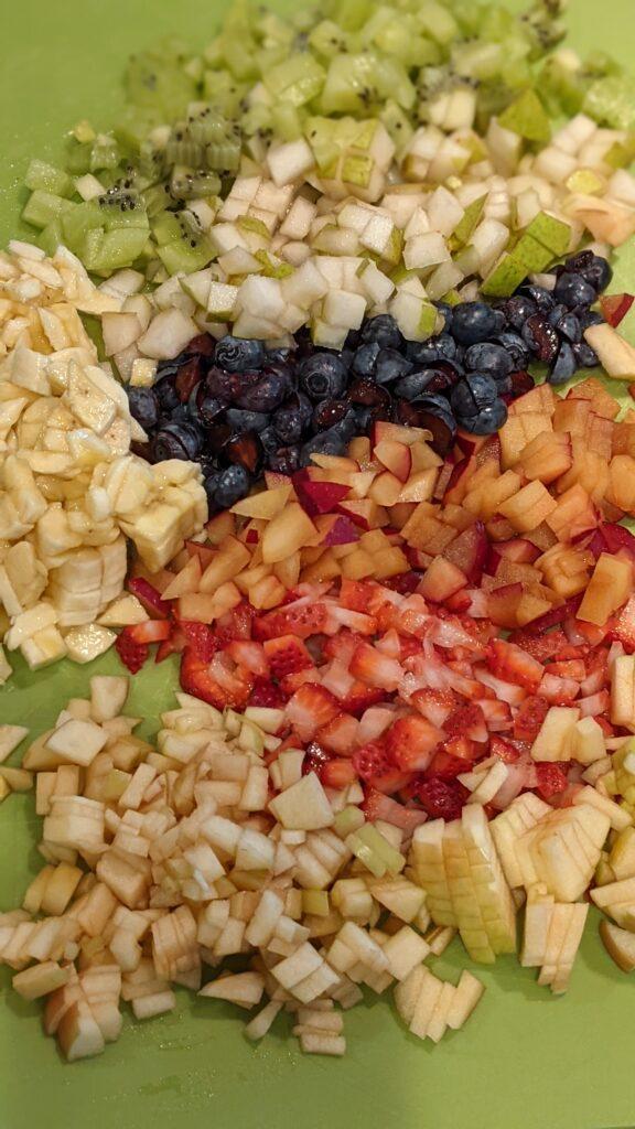 Diced fruit on cutting board.