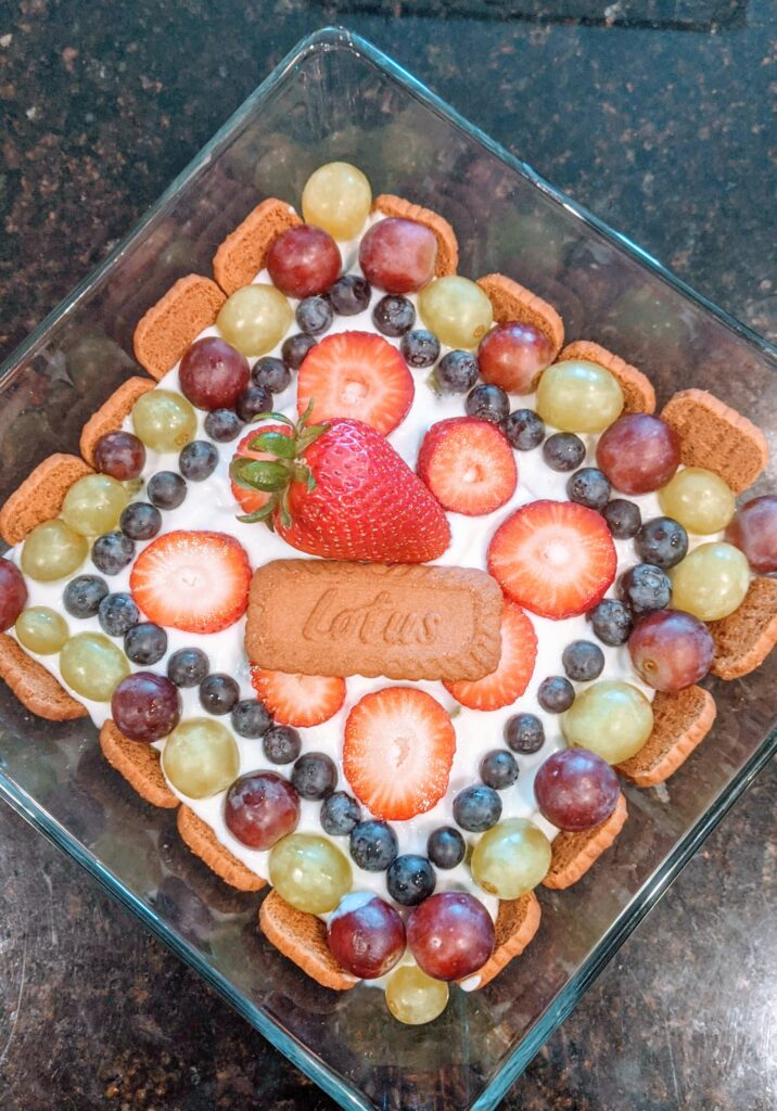 Decorative fruit top with cookie in middle.