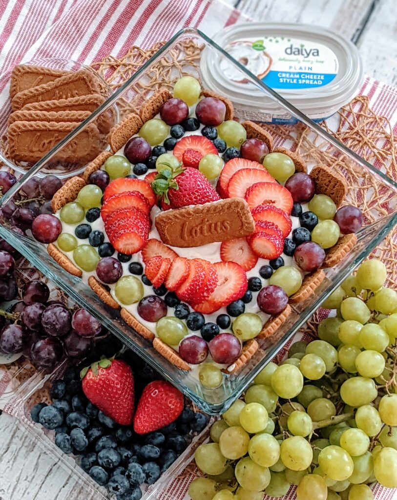 Fun Fruity Biscoff Trifle surrounded by ingredients.