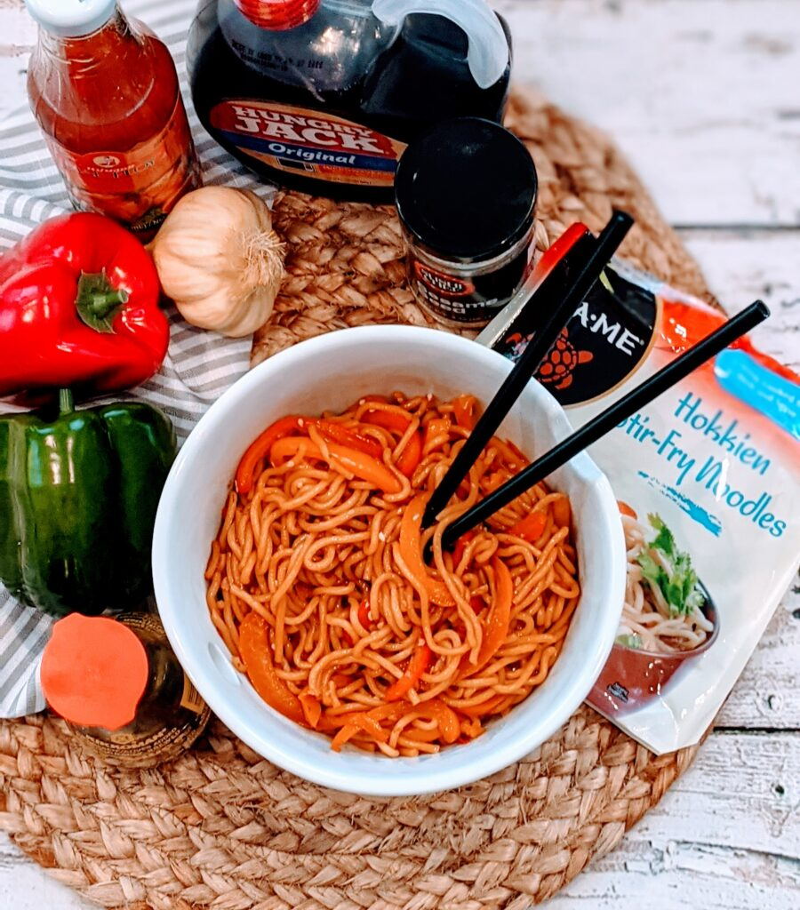 Finished Easiest Stir Fry Noodles with surrounding ingredients.