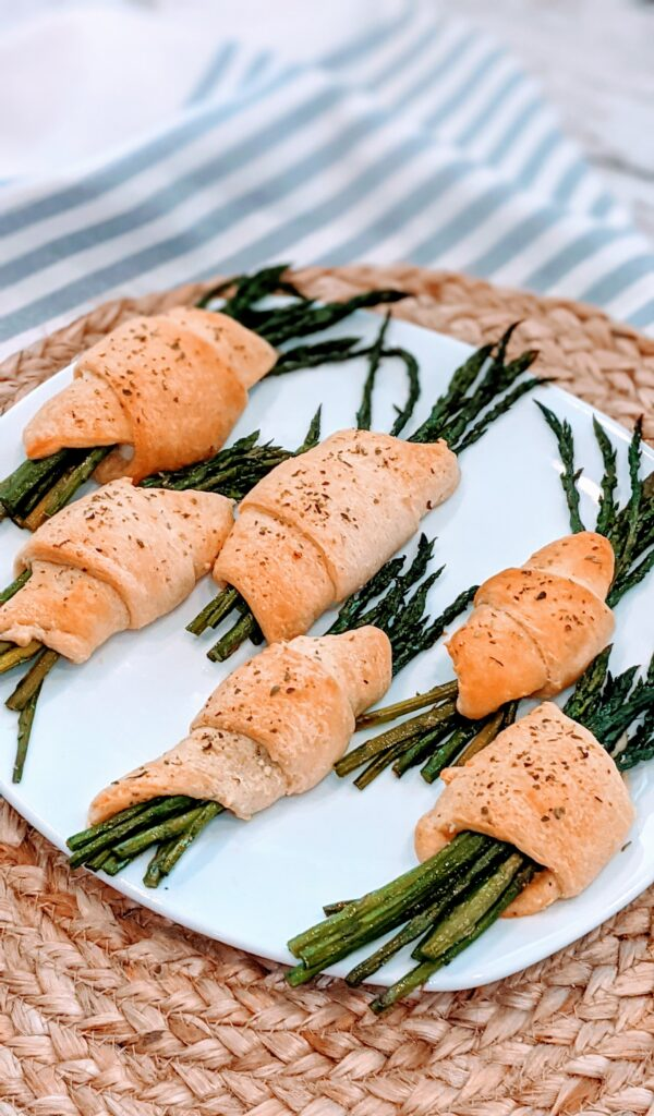 Crescent Rolled Feta Asparagus on white serving dish.
