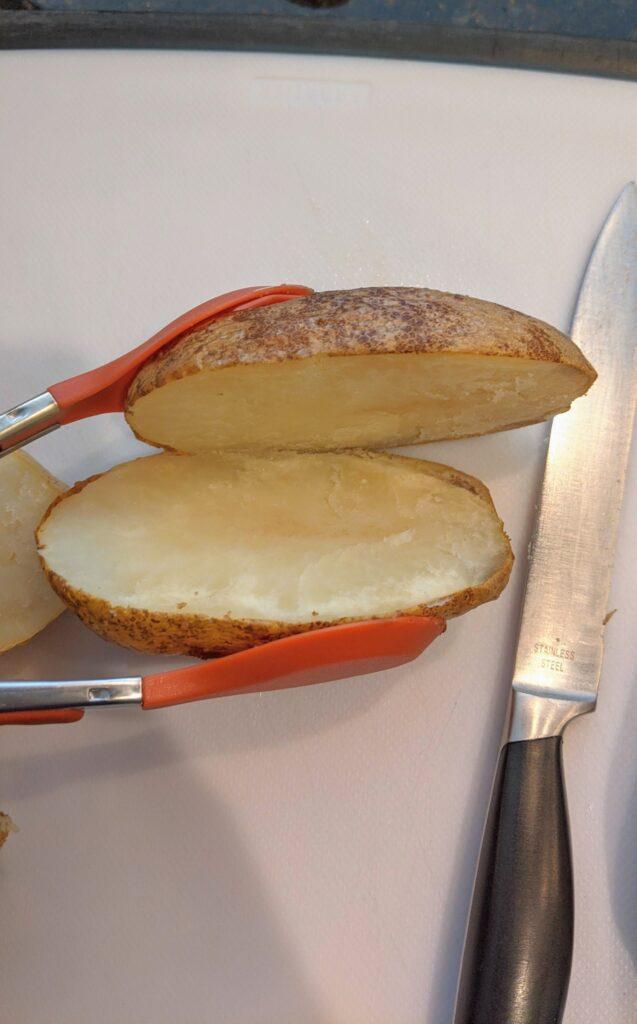 Baked potato sliced in half lengthwise.