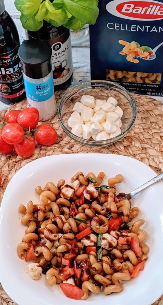 Individual dish of Glazed Caprese Cellentani with surrounding ingredients.