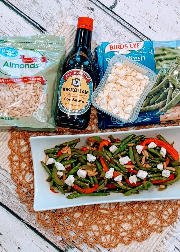 Simple Sauté Green Beans & Peppers in white serving dish alongside ingredients.