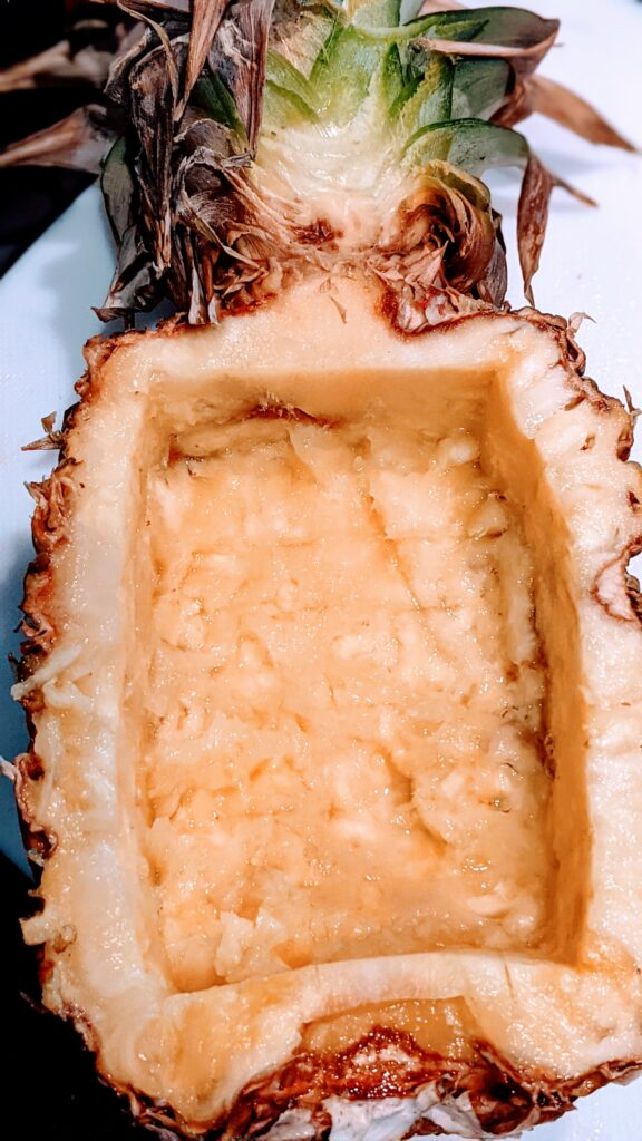 Hollowed out half of a pineapple ready for fried rice.