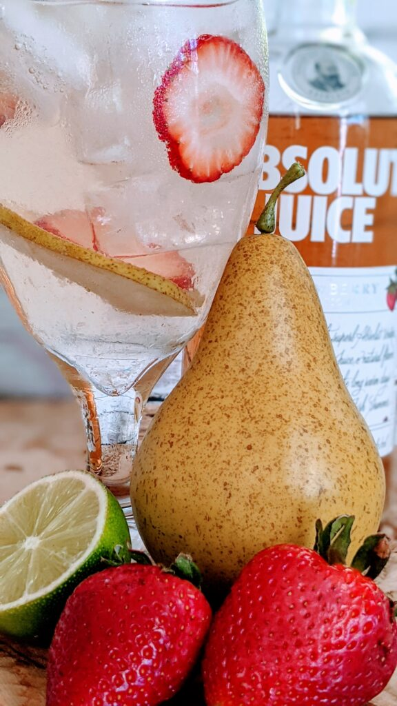 Absolut Strawberry Pear Cocktail with surrounding ingredients.