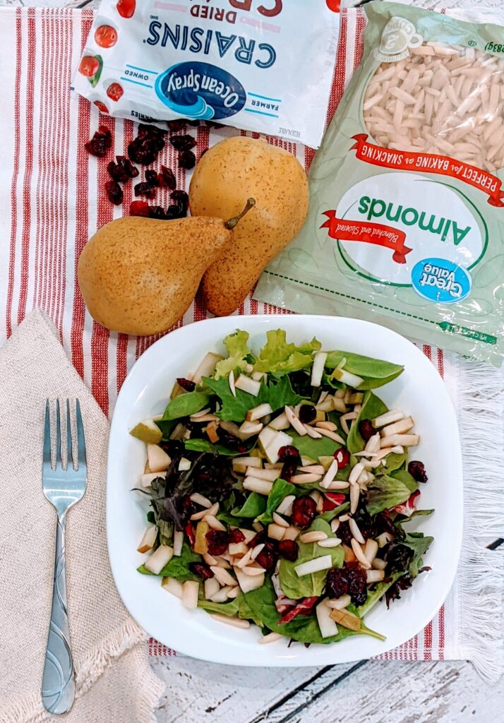CRANBERRY PEAR SUPER SALAD with surrounding ingredients.