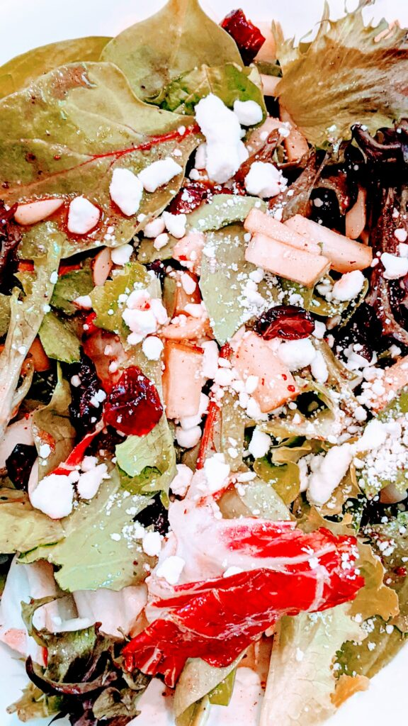 Close-up of salad with goat cheese.