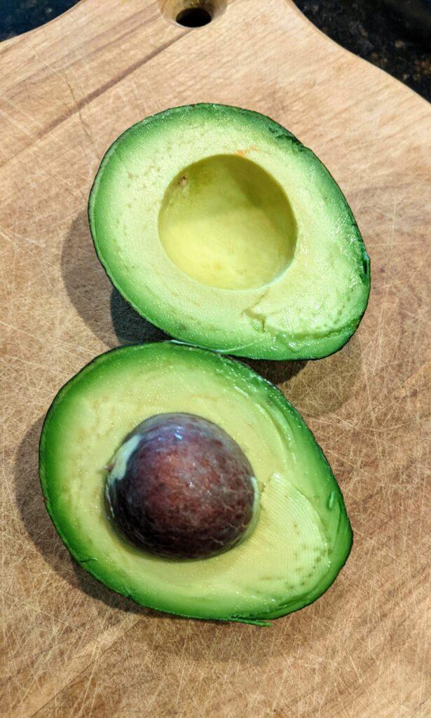 Avocado sliced in half lengthwise.