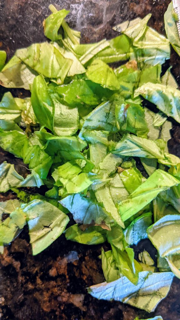 Chopped fresh basil ready to be added to mixture.