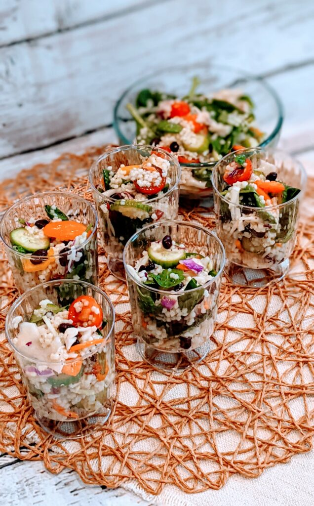 Salad in individual serving cups in addition to a individual bowl of Simple Summer Salad.
