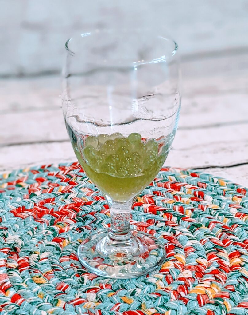 Bursting Boba in glass on colorful placemat.